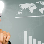 A business man pointing at an idea lightbulb